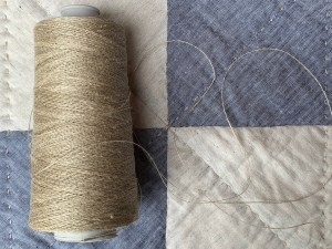Product photo for fine organic linen sewing thread